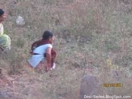 Indian village girl pissing outdoor