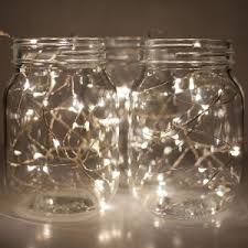 mason jars lighting. place battery operated fairy lights in mason jars white are an elegant option for lighting