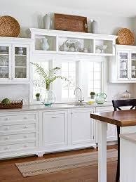 Modern White Kitchen With Colourful Kitchenware  Kitchen Kitchen And Floor Decor