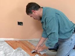 use laminate roller to set tile in place