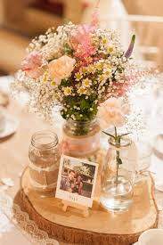 Pastel Rustic Table Centerpieces With Polaroid Photos