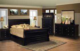 awesome black bed set made of wood by kathy ireland furniture on wooden floor which matched