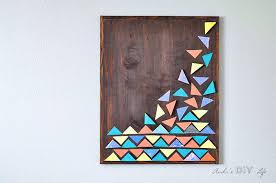 diy wood wall art with colorful geometric triangles on mounted on wall