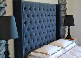 blue tufted headboard. Plain Blue Blue Velvet Tufted Headboard With Black Baroque Lamps In A