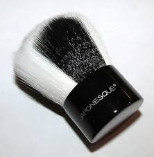 the safari chic bronzer brush is a super soft leopard print dess firm yet pliable enough to apply your bronzer or really any powder to perfection in