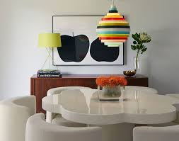 artsy lighting. colorful accent lighting in midcentury dining room design alison damonte artsy