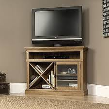 scribed oak effect home. this sauder barrister lane scribed oak corner tv stand can easily accommodate your flatscreen television it features open shelving to house effect home