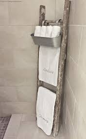 This With Some Type of New Floor Basket Beside it on Empty Wall in Bathroom.  Old rustic ladder used as towel rack with galvanized hanging bucket for  wash ...