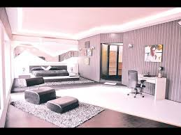 The Bedroom Has Huge Double Bed With Black Satin Sheets. The Lighting In  The Bedroom