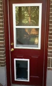 dog door installed through a people door with glass above