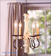 four candle chandelier in pendant light is an easy update