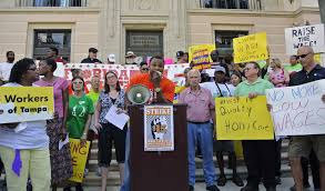 workers protest low wages in tampa area com charles jefferson speaks at the podium during the fight for 15 protest at st