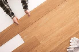 wooden flooring installation at home stock photo
