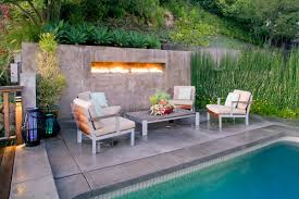 arto built a rounded half wall around this gas fire pit to protect guests from getting by flames