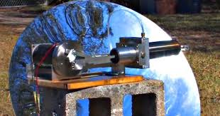 this is a larger stirling engine powered by concentrated solar is water cooled it has a 12v dc permanent magnet motor operating fixed as the flywheel