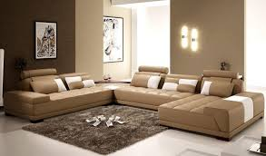 brown living room with u shaped sofa in cream tone with shabby brown rug and brown accented wall