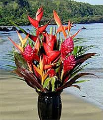 kauai arrangement our um size bouquet is a perfect choice to share the colors of the islands this enchanting array conns larger flowers than the