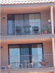 glass is suncoatmax before and after picture of a milgard aluminum retrofit door color is bronzed aluminum and