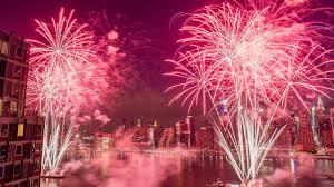 4th of July fireworks light up sky over East River