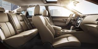 nissan altima interior showing front and rear seats in beige leather