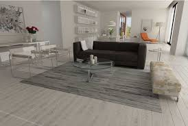 gray and white area cowhide rug in stripes in an open living room