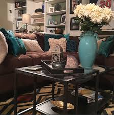 Cozy brown couch with teal accents, turquoise and brown, built-in shelves,