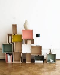 above ikea s diy version of stacked shelving featured in livet hemma is made of wood boxes with painted interiors fastened with ordinary office binder