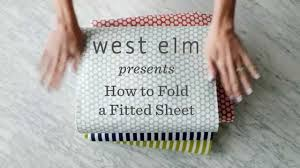 fold fitted sheet how to fold a fitted sheet the easy way west elm youtube