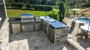 a recent install of an outdoor kitchen for a resident tarpon springs area featured is granite and matching stonework with a blaze gas grill and multiple