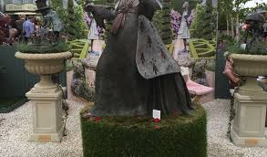 print original size back to lovely alice in wonderland garden statues