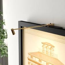 pin on wall of frame