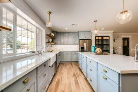 blue shaker cabinets with gold hardware