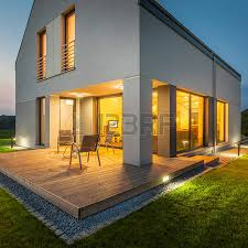 view modern house lights. External View Of Modern House At Night With All Lights On Photo D