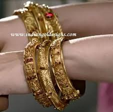 checkout khazana jewellers designer antique gold bridal bangles studded with ruby stones