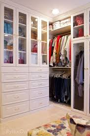 closet cabinets with drawers and glass doors