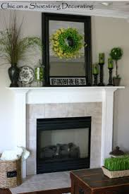 decorations sensational white stoned mantel with spectacular green ornate foliage also superb green decorative candles exciting classic and modern mantel