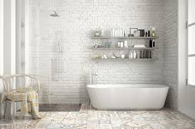 inviting white bathroom with vintage style patchwork floor tiles