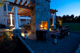 pea gravel seating area with double sided outdoor fireplace traditional patio