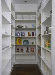 u shaped pantry with white shelving units and coffee stained hardwood floors