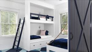 white built in bunk beds with navy safety rail