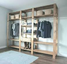 free wardrobe systems with doors sliding door track standing closet closets bedroom organizers in wood gorgeous