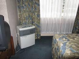 Coast Plaza Hotel U0026 Suites: Portable Air Conditioner In Corner Of Hotel  Bedroom