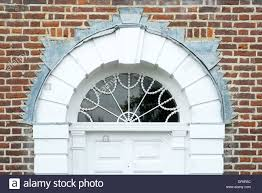 Decorating circular door images : Ornate white door way with decorated semi circular glass panel and ...