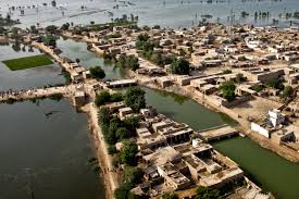 u s department of defense photo essay an aerial view of a town surrounded by flood water seen as u s marines land their
