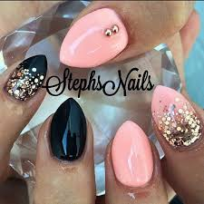 baby pink and black stin nail with glitter accent