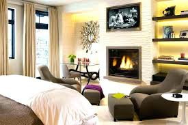 master bedroom with fireplace s black mantel and surround