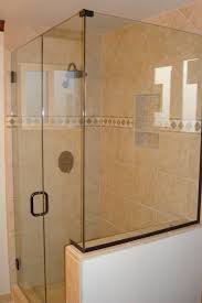 contemporary bathroom with frameless glass shower doors and shower anclosures