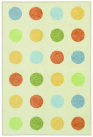 this area rug features a whimsical polka dot design and soft durable fibers the natural field is highlighted with shades of baby blue light yellow and