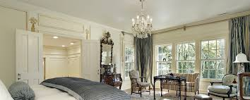 standard height for a chandelier in the bedroom is 7 feet from the floor to the bottom of the chandelier but it may hang a few inches lower if placed over