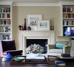 fireplace mantel bookshelves living room traditional with wood trim purple lounge chair purple velvet chair